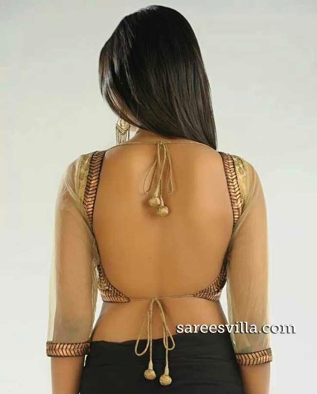Model In Backless Blouse
