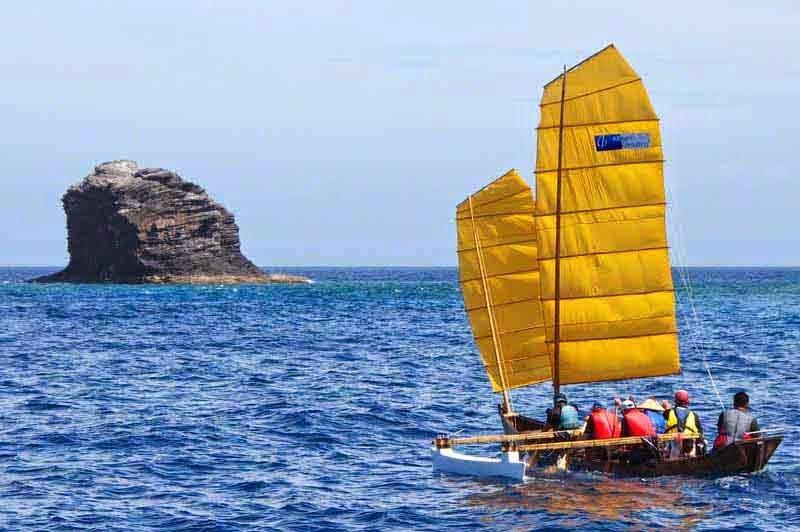 traditional sailing sabani boat,yellow sails, outrigger