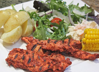 tandoori style chicken breast strip salad with potatoes