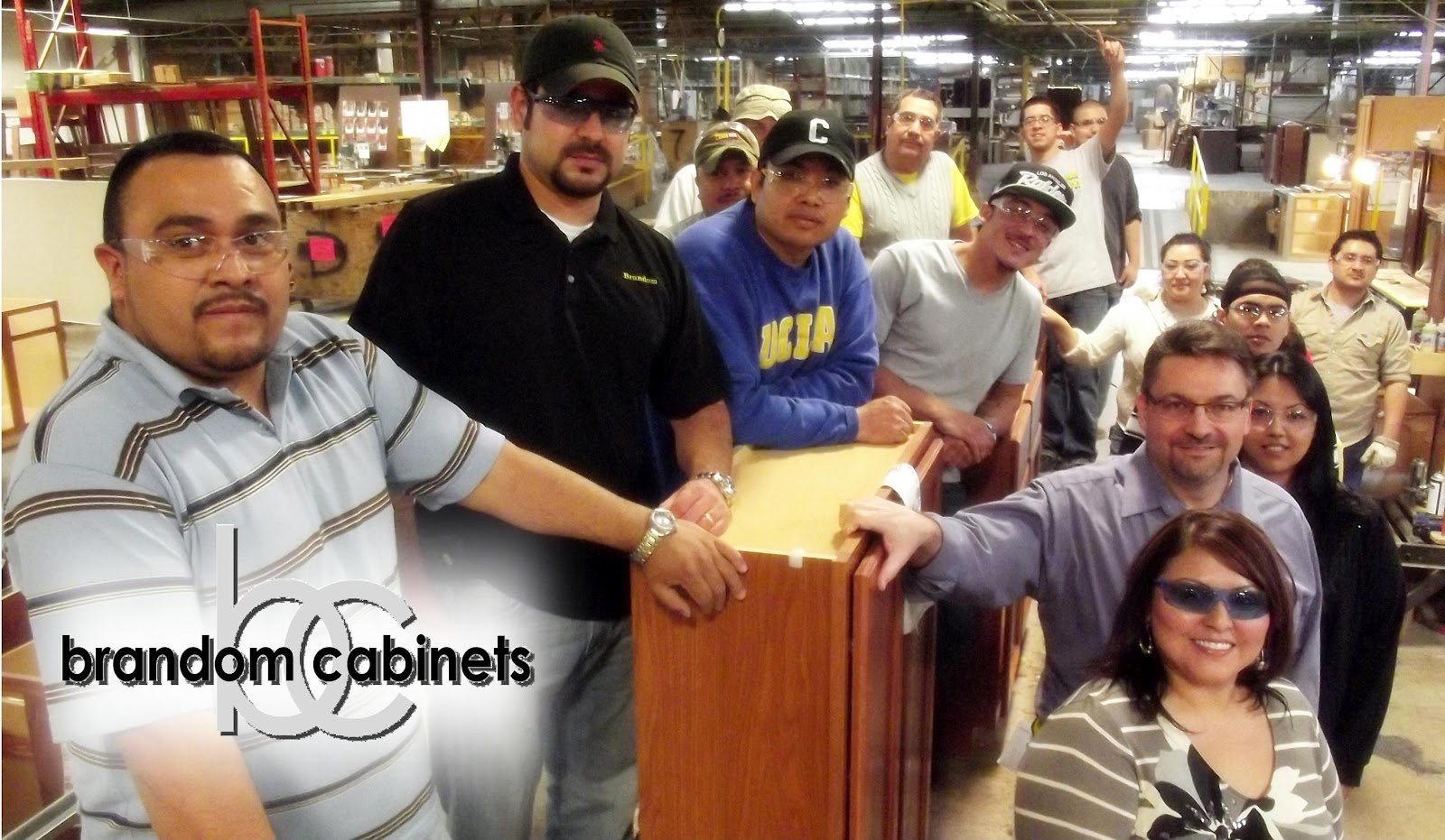 , Tim Bear (pictured lower right) with assembly line staff
