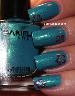 Dotted flower nail art using Barielle polish
