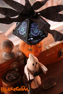 An autumn arrangement of found objects and limited Halloween art lantern by Bindlegrim