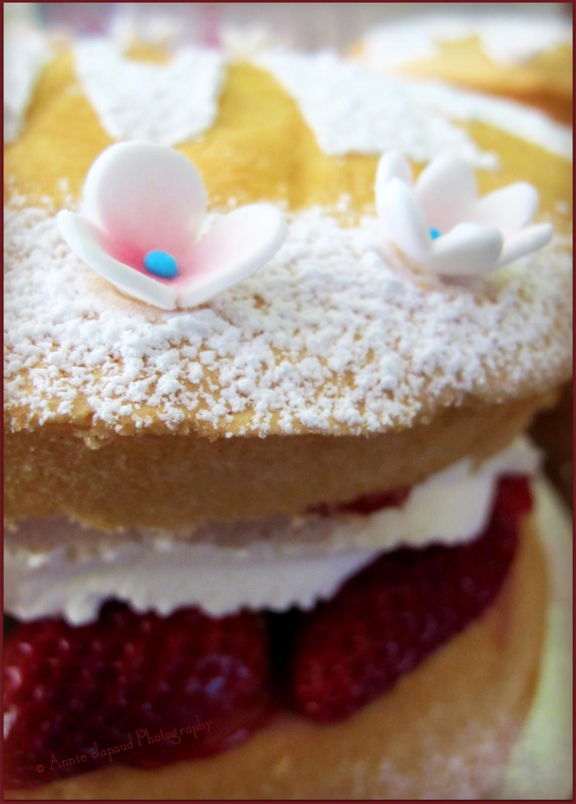 image of a cream and strawberry cake up close