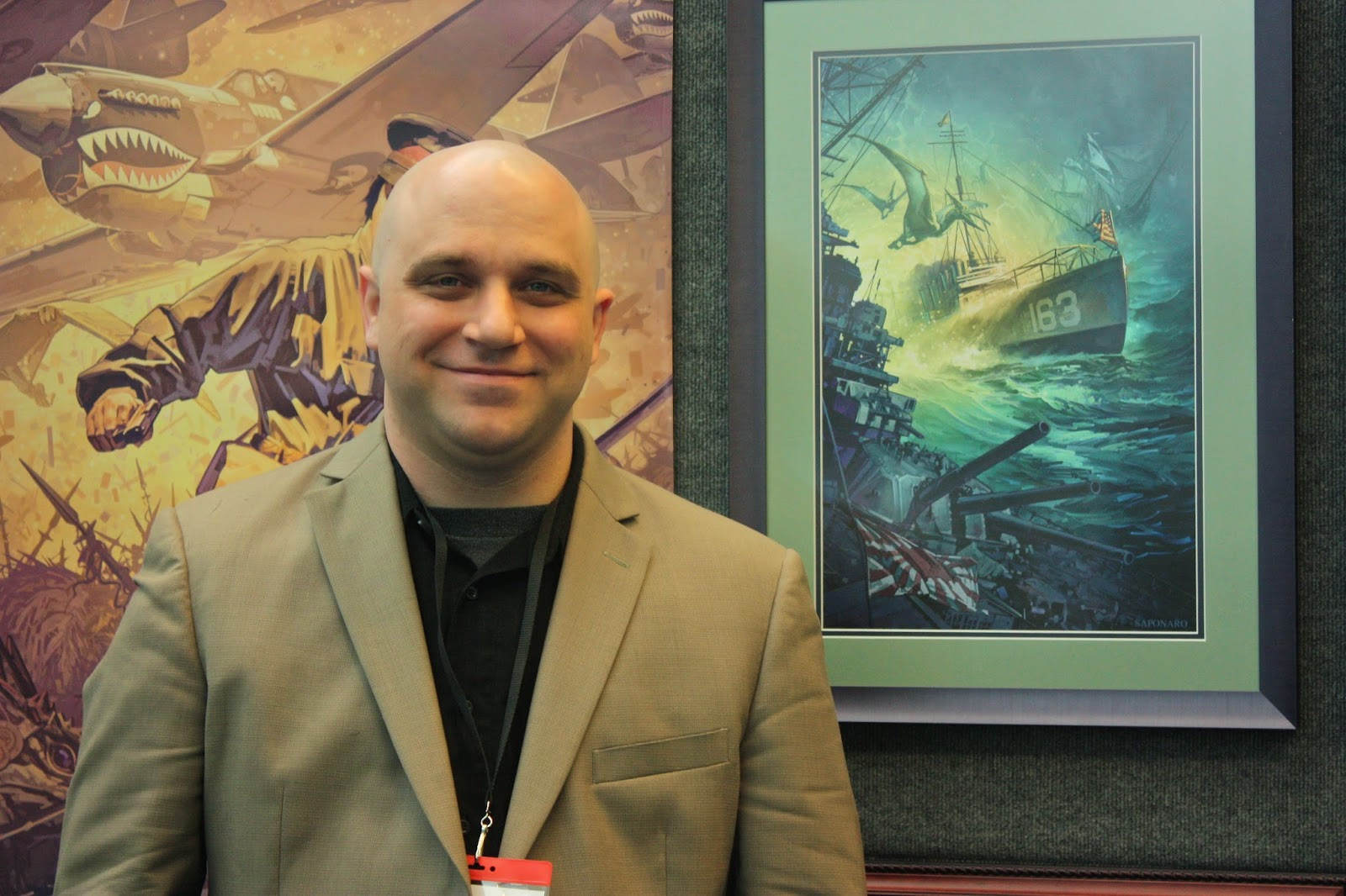 Dominick Saponaro at Spectrum Live in front of Destroyermen I Painting
