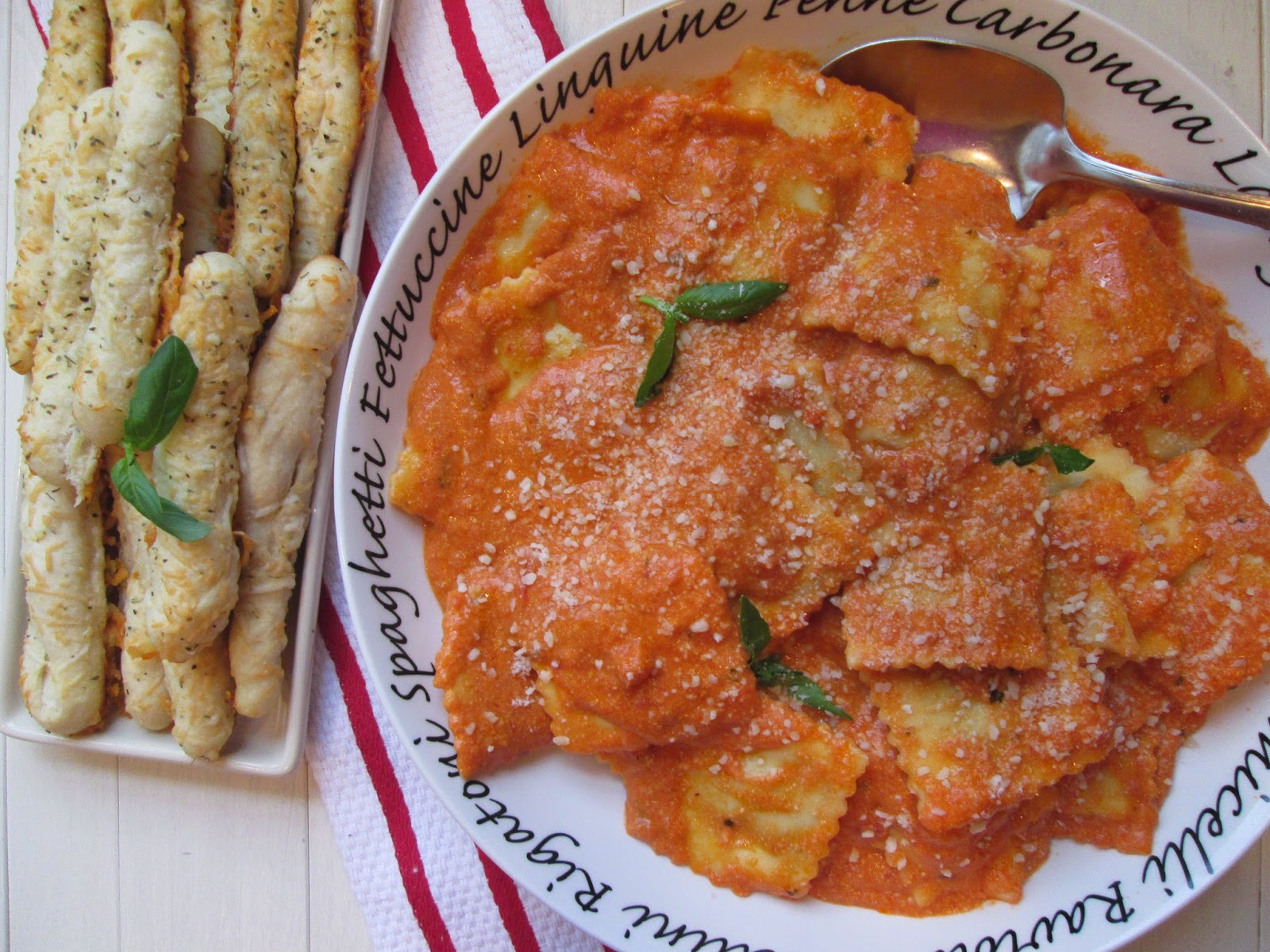 Ravioli with Creamy Tomato Sauce and Cheese and Rosemary Breadsticks