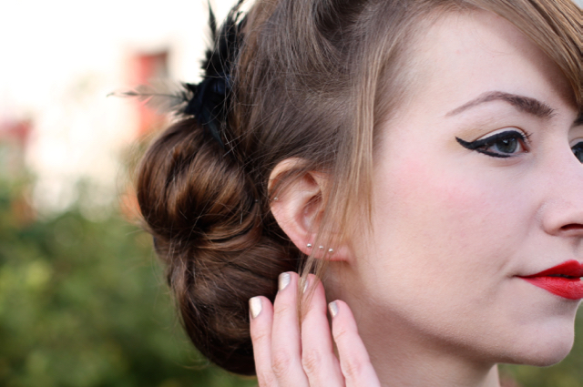 Side bun with hair feather