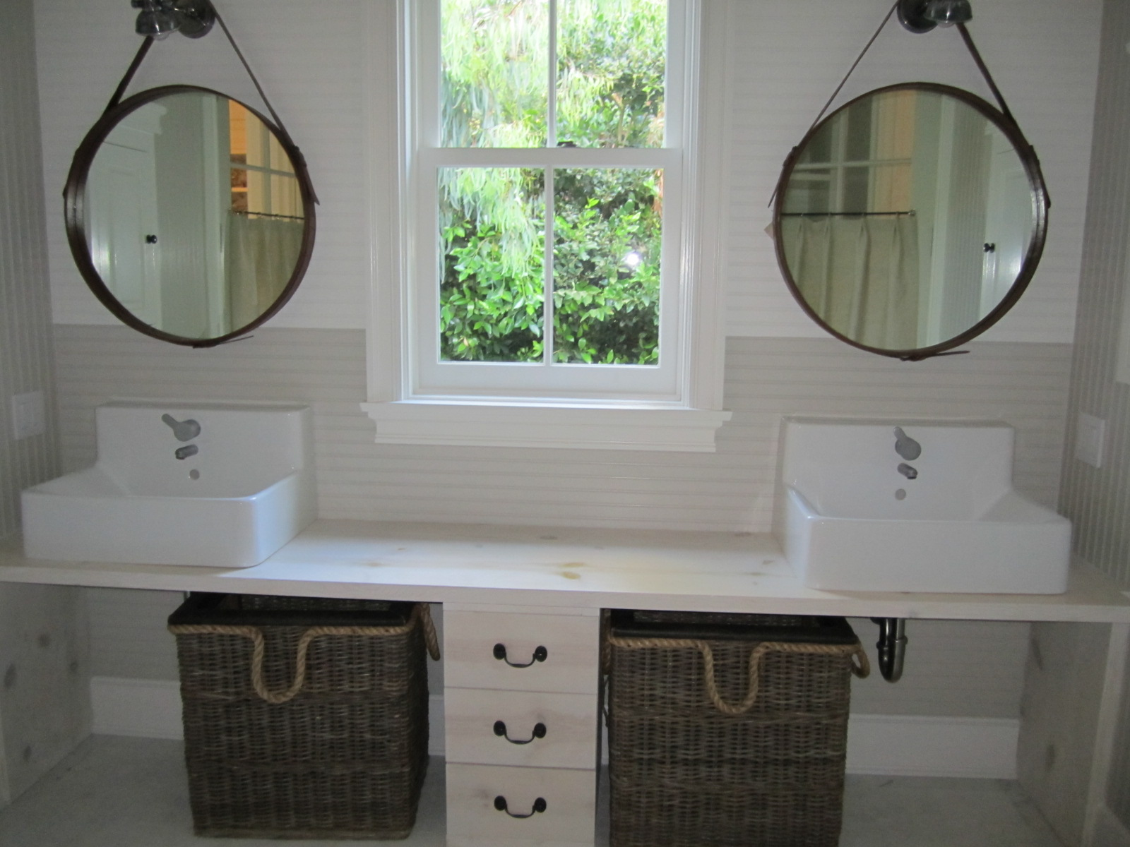 Grey Laundry Room With White Cabinets