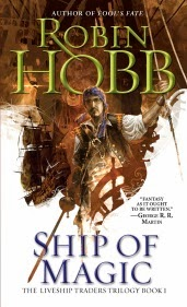 cover art for Ship of Magic, featuring a pale skinned man wearing a kerchief and carrying a sword arrayed against a background of ships' sails