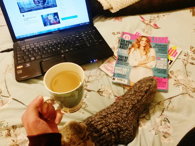 Relaxing with tea, magazines and laptop