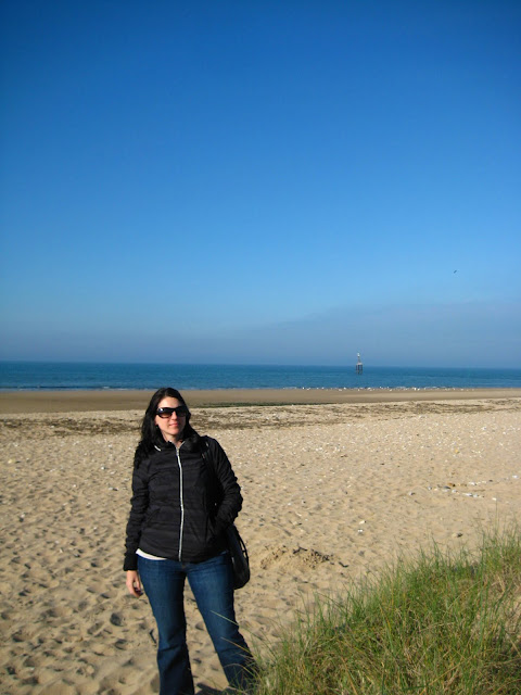 Woman standing on Juno Beach, France.