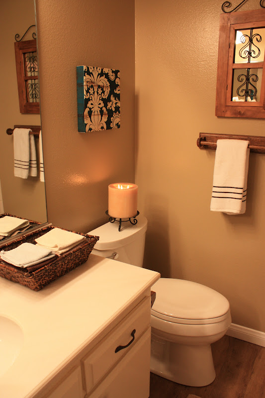 The small Spanish style mirror on the wall was bought at a Pier One many  years ago  It had been in the master bath over the tub and I simply moved  it. BALANCED STYLE  Boys Bathroom REVEAL