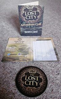 Minigolf scorecards and a coaster from The Lost City