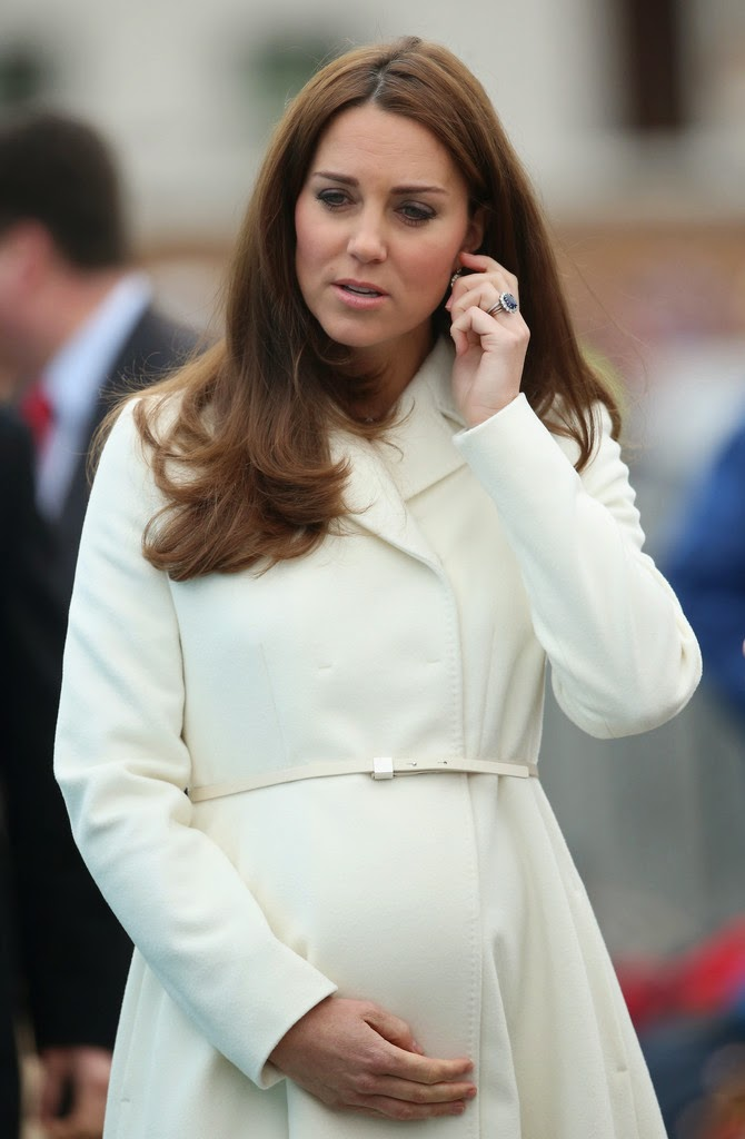 Kate Middleton flaunts baby bump in a white coat and printed dress at the Ben Ainslie Racing in Portsmouth