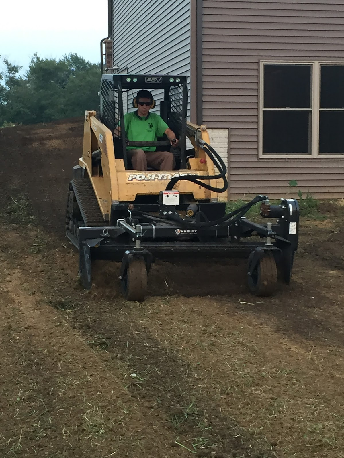Finish Dirt Grading In Blue Grass Iowa: How To Properly Slope A Yard