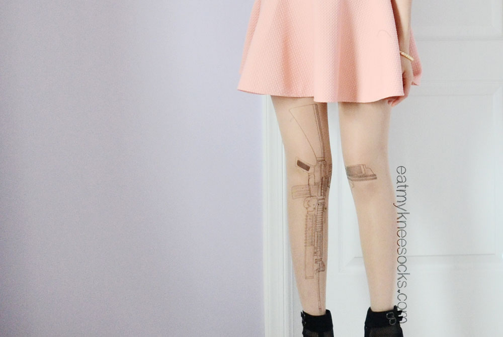 The tattoo-style sheer gun-print tights from Brave Store.