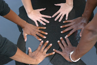 Hands joined in a circle.