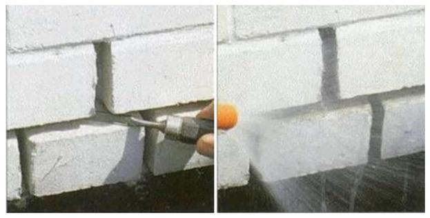 Процесс удаления старого раствора со швов кирпичной кладки