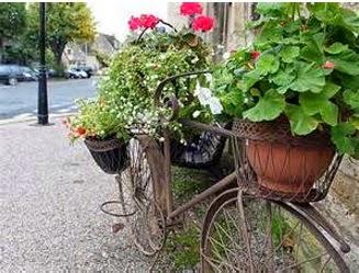 A mi manera reciclaje para decorar el jard n for Ideas para decorar el jardin con llantas