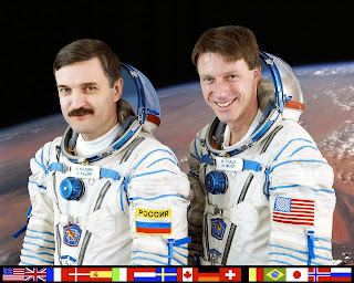 Expedition 8 Crew Featuring Mike Foale and Alexander Kaleri in Sokol Suits