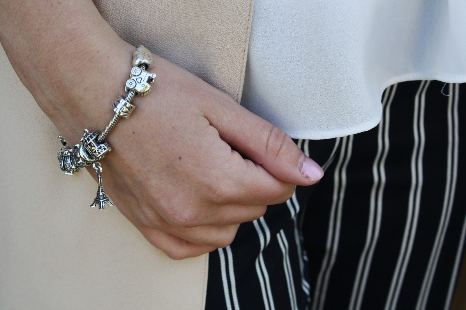 Close up shot of silver Pandora charm bracelet