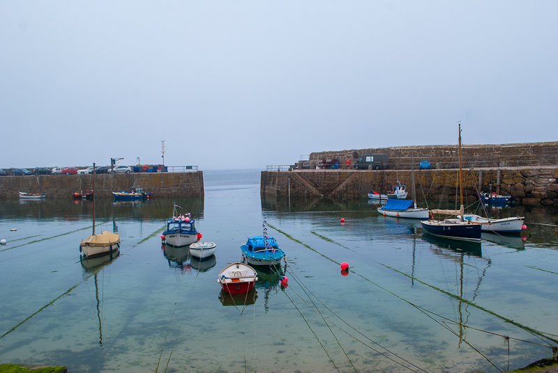Harbour sights with small boats in mouse hole cornwall, england