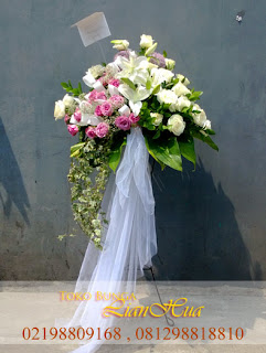 bunga standing duka cita jakarta