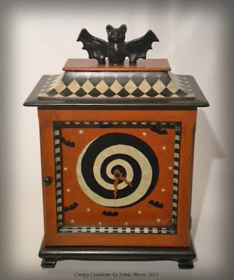 https://www.etsy.com/listing/232268966/whimsical-halloween-antique-mantel-clock?ref=shop_home_feat_3