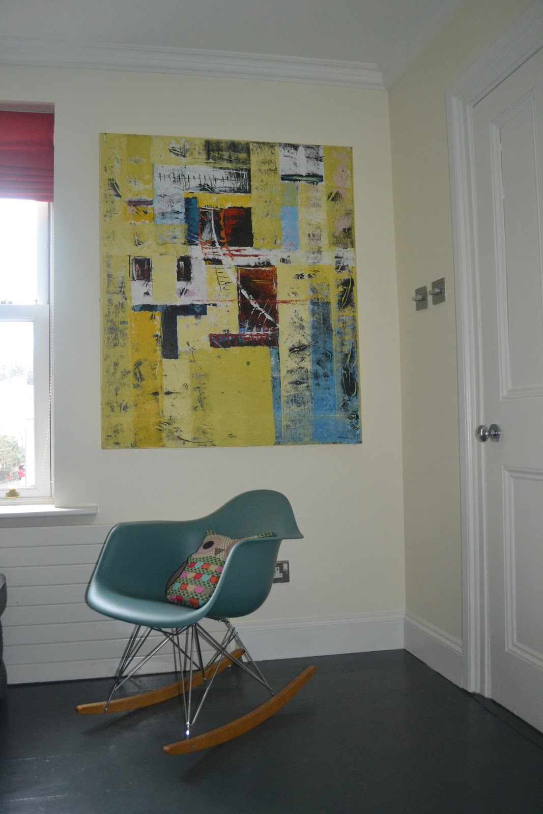 AFTER: The Eames rocker by Vitra (purchased at Arnotts) perches on the  title=