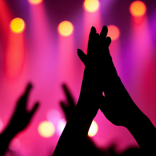 Hands clapping at a concert