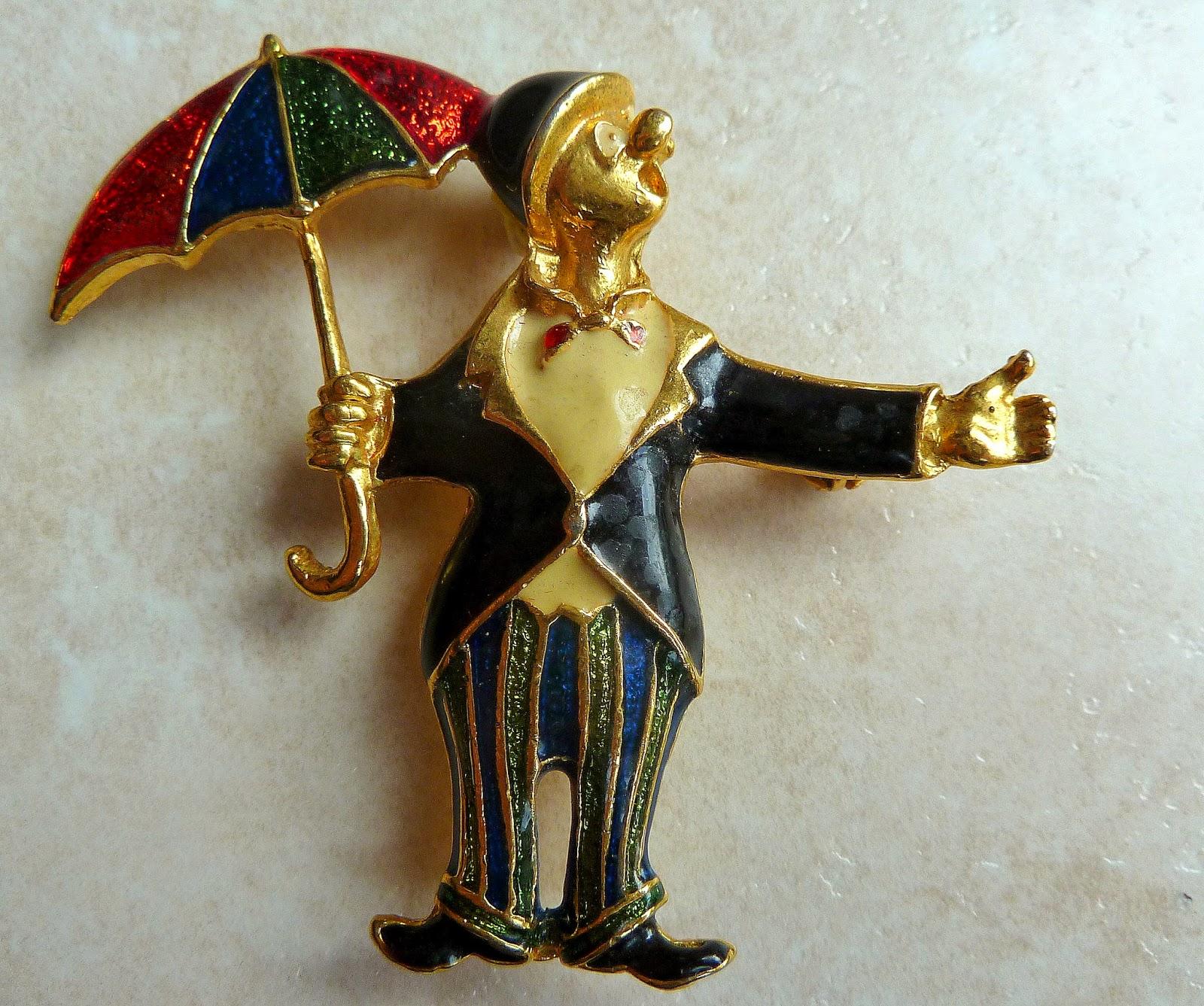 http://www.kcavintagegems.uk/vintage-clown-in-the-rain-brooch-132-p.asp