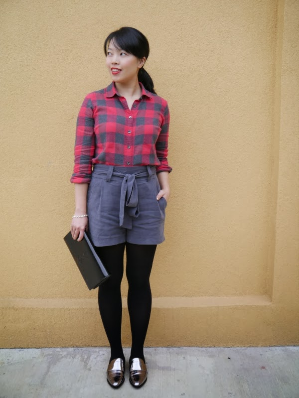 Vancouver blogger Lisa Wong of Solo Lisa wears a J. Crew buffalo plaid shirt, CiCi grey tie-waist shorts, 3.1 Phillip Lim silver loafers, a silver Maison Birks charm bracelet, and a Saint Laurent 'Belle de Jour' clutch in black patent.