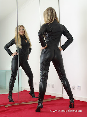 Nadia Posing in the Mirror Black Leather Catsuit and Heels