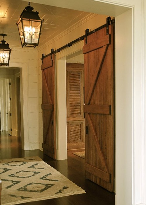 these sliding barn doors are great in this space the colors light