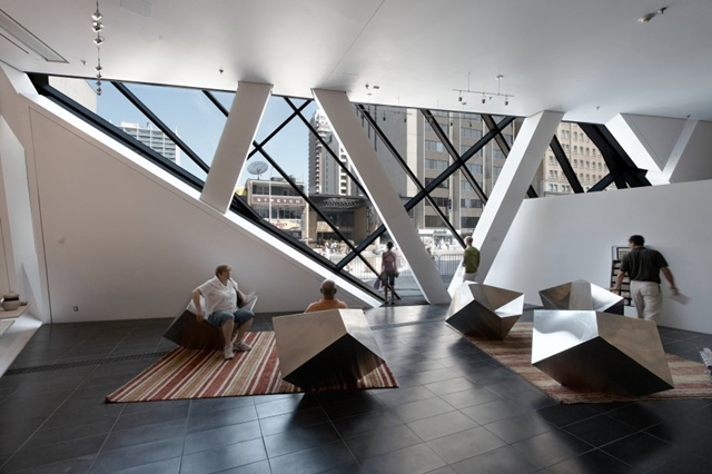 Royal Ontario Museum by Studio Daniel Libeskind interior with small designed chairs and carpeting on the floor