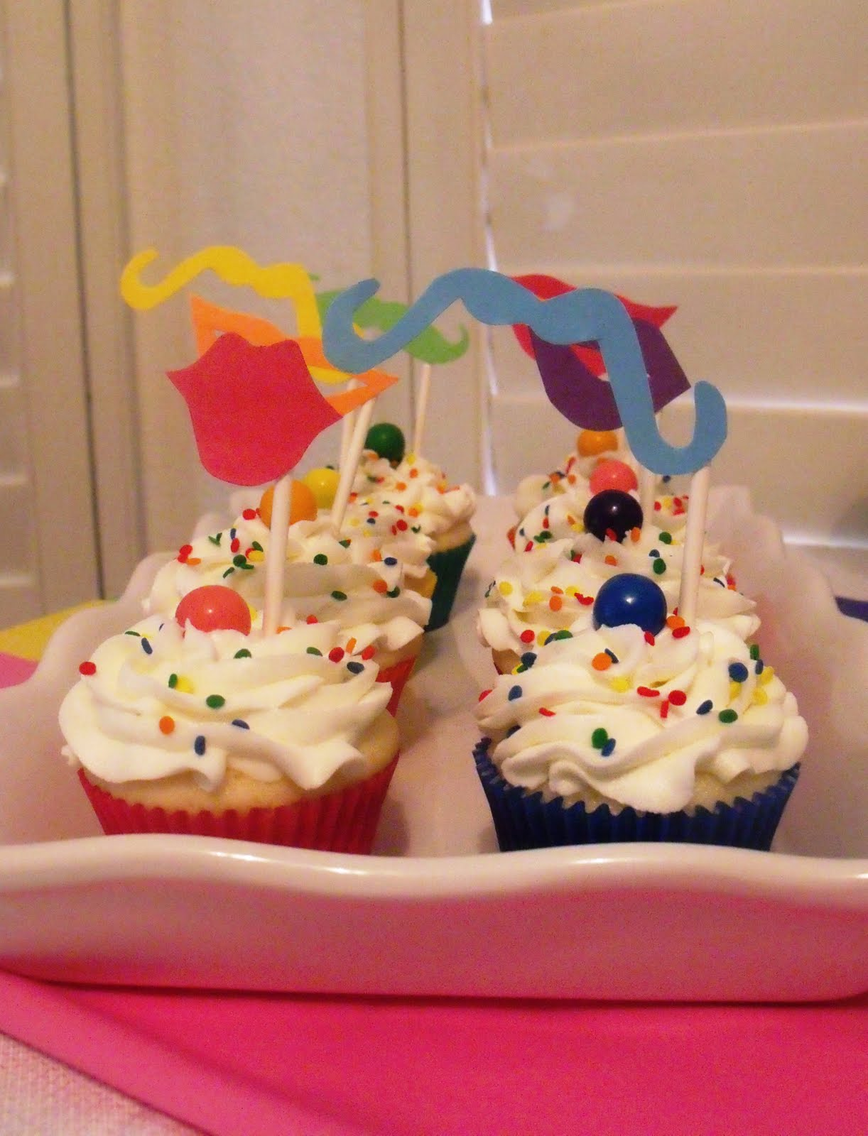 Sugar rainbow party cupcakes with mustache and lip picks