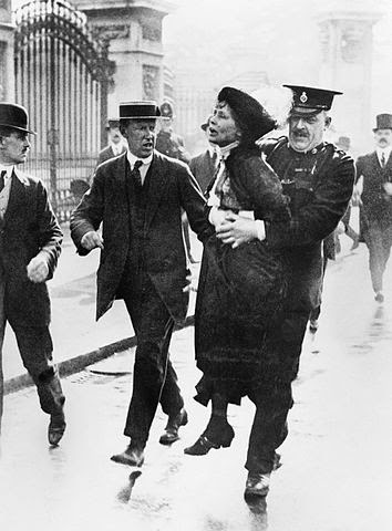 The leader of the Women's Suffragette movement, Mrs Emmeline Pankhurst is arrested by Superintendant Rolfe outside Buckingham Palace, London while trying to present a petition to HM King George V in May 1914.  This image was created and released by the Imperial War Museum on the IWM Non Commercial Licence http://media.iwm.org.uk/iwm/mediaLib//8/media-8597/large.jpg