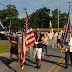 Flag Day in Cedar Lake, Indiana.  A Democrat showing a Freudian slip and a young Republican with a good story.