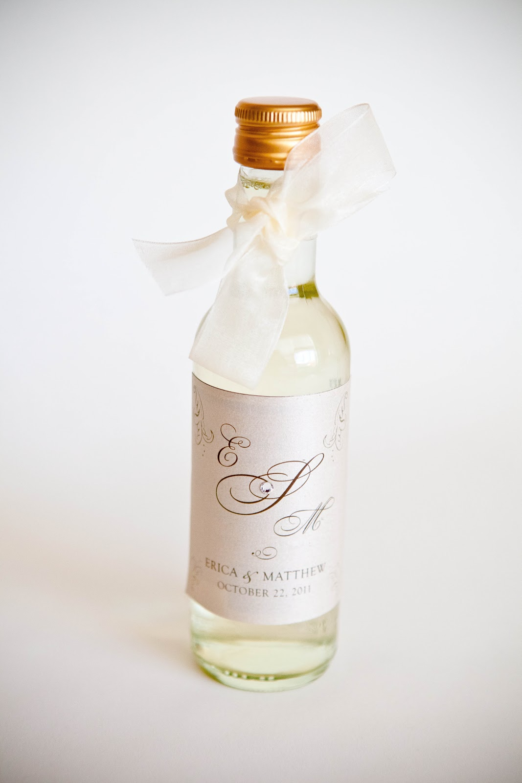 here are some wedding and bridal shower favors wine bottles with a customized label and ribbon you can even add bling