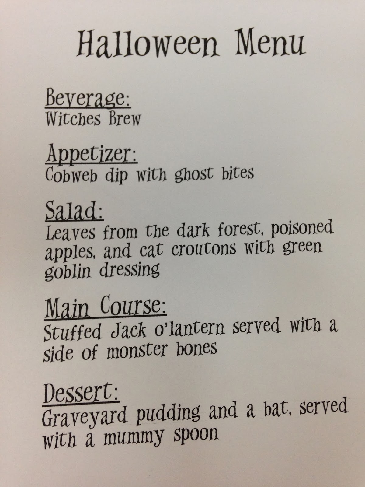 we celebrated halloween this year by having a spooky dinner i set up a place for my husband and i at the table and gave him this menu