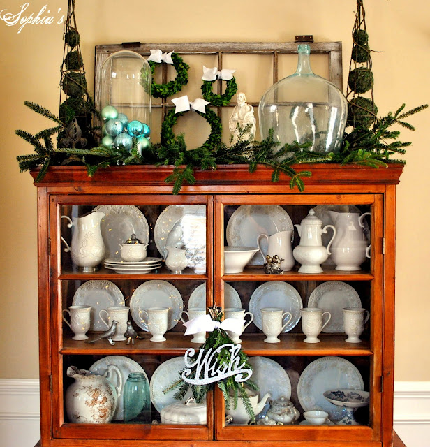 Sophia 39 s a christmas cabinet and a story for Christmas decorations for top of kitchen cabinets