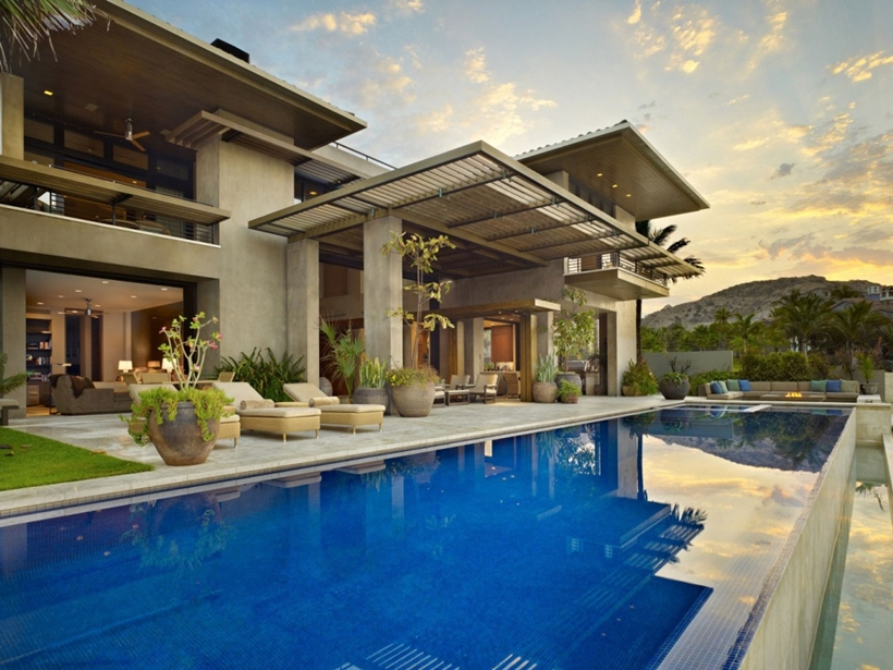 Swimming pool in the Gorgeous modern stone house on the beach