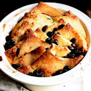 Bread and Butter Pudding. Classic dessert of bread and raisins cooked in custard base in a pudding dish.