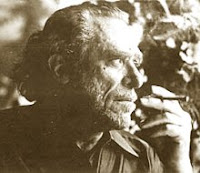 A photo of smoking and introspective American poet Charles Bukowski