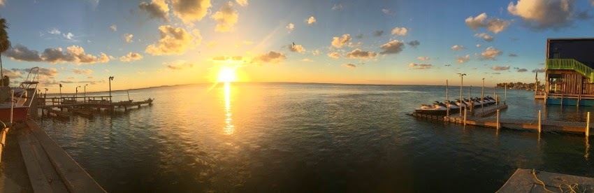 Panoramic iphone photo of the sun setting over the Laguna Madre in South Padre Island Texas