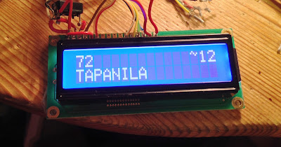 [Image: Photo of a small liquid crystal display kit with its PCB showing, obviously home-soldered to a bunch of wires, and displaying the text: '72 TAPANILA ~12'.]