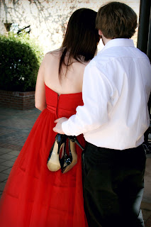 Prom Couple holding shoes
