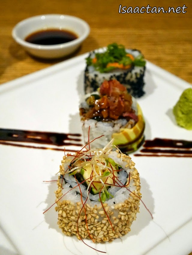 Three types of sushi, the Spicy Tuna Roll, Unagi Cheese Roll, and Salmon Avocado Bacon Roll for our consumption