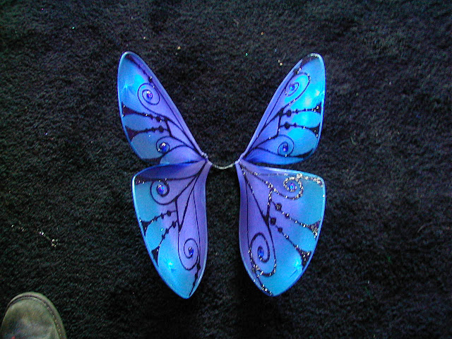 flouresent blue+and purlpe butterfly wings with sparkly black veins