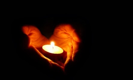 Becoming a Curator - candles hand holding carrying flame dark darkness