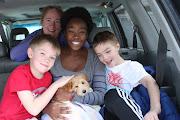 Hazel Mae snuggling in with her new family. (img )